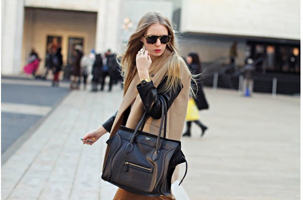 Coat with leather sleeves