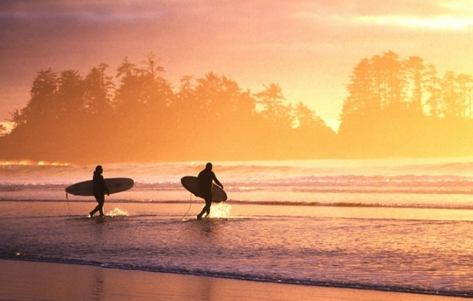 Sunset Surfers at Chesterman Beach Tofino Adrian Dorst, is one of the 3 Must-See Hidden Secrets of British Columbia